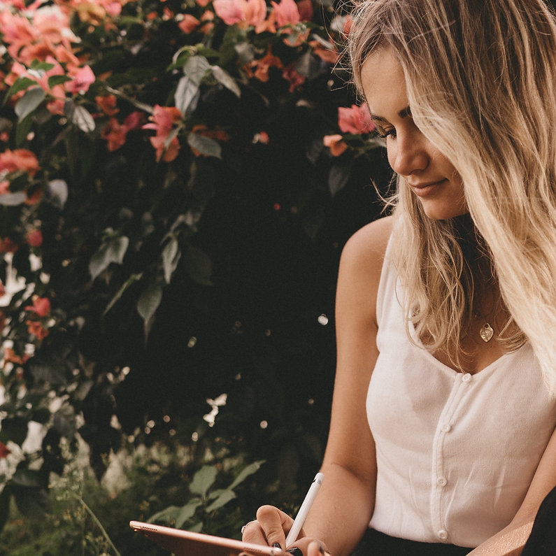 woman-writing-on-ipad-3082804_edited_edi