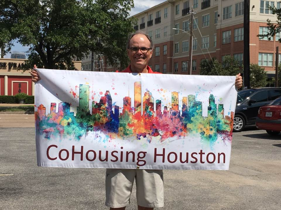 Tom with Cohousing banner