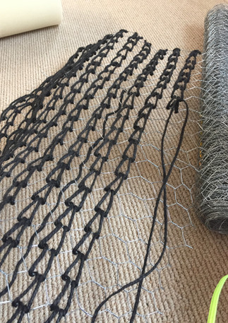 Wire and jute being readied for sculptured form