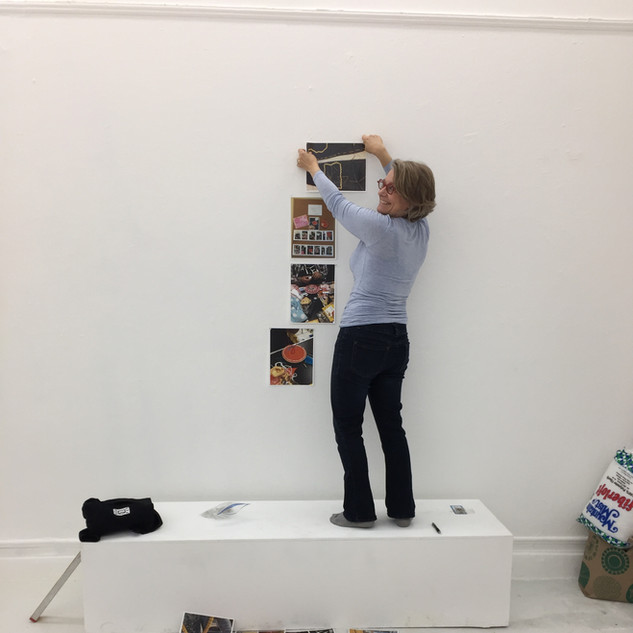 "Installing ""Away From Home Art"" Exhibition"