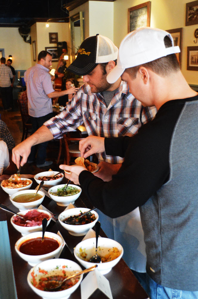 Chef Nick Helping Guests Build Tacos
