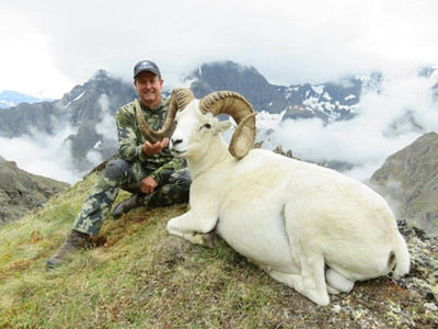 Kevin  Small from  Bakersfield,  CA  and  guide  Dan Montgomery,  with Kevin's  magnificent  Chugach  Mts.  ram;  43  4/8  X  42  7/8  X  13  6/8,  official B&C score 172 3/8.