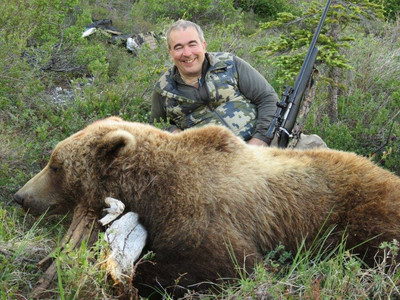 """Steve Menore from Rockford, IL with his beautiful 7'10"""" grizzly/brown  bear."""