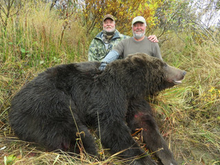 Mark Jordan(right) and brother John Jordan(left) with Marks 9' boar.