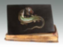 An Italian marble micromosaic of a salamander and butterfly sold by Suffolk auction house Lockdales