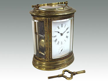 19th Century gilt brass oval carriage clock from Suffolk auction house Lockdales