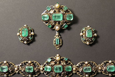 A suite of Russian Emerald set silver jewellery sold by Suffolk auction house Lockdales