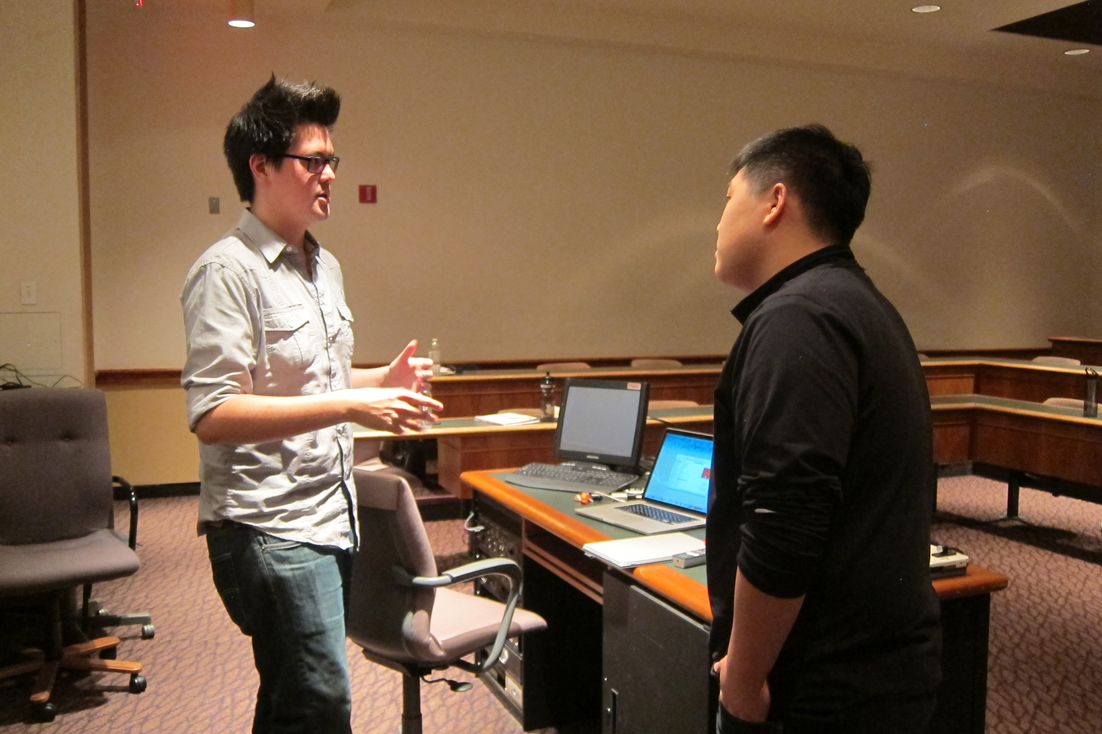 Jordan DeVries talking to Chunwoo Baik