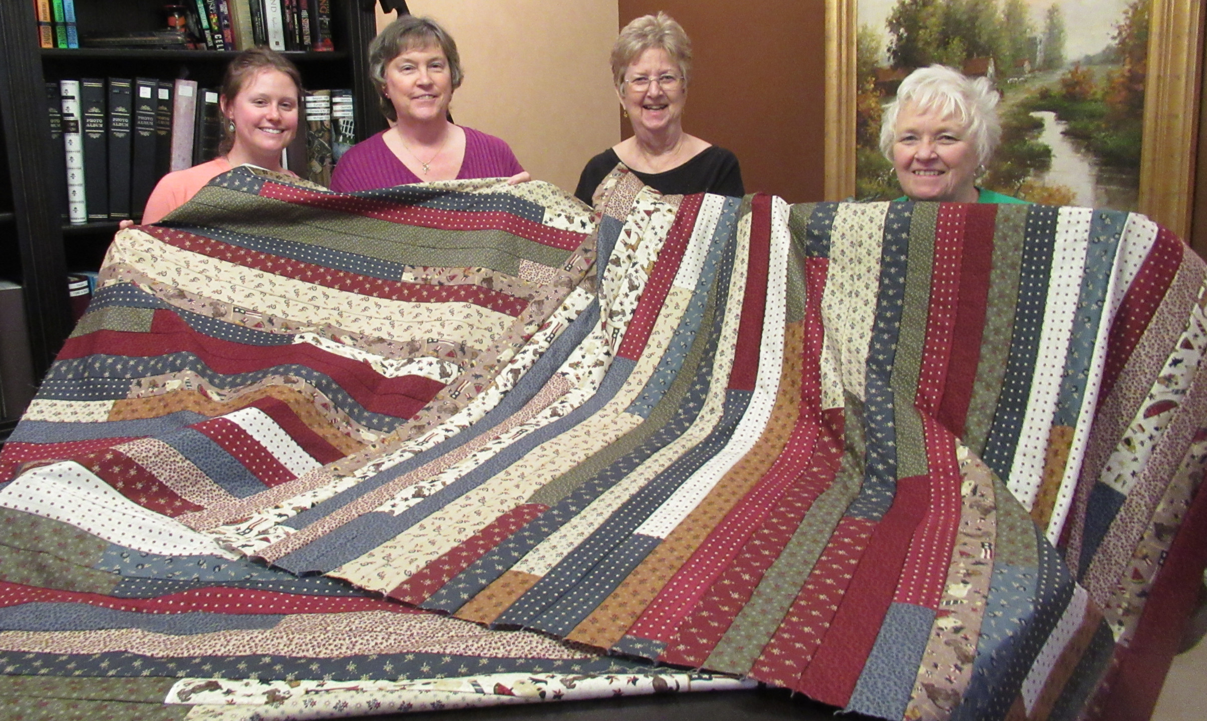 Quilts of Valor made by Jenna, Janice, Nancy & Gladys. Soon to be quilted and then donated.