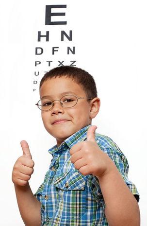 boy in front of eye chart.jpg