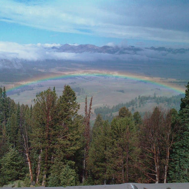 Looking down on a rainbow in the Idaho Sawtooth valley.