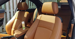 BMW 3 Series Coupe beige leather seats and interior with a Colourlock protection bottle
