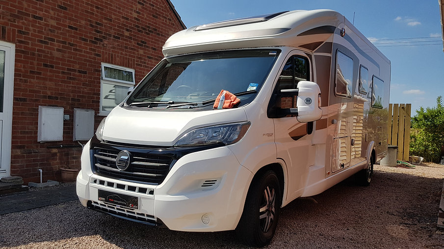 White ceramic coated Fiat Ducato van with a Coating Farm Ceramics bottle on a microfibre and Mobi ValetingDetailing custom plate