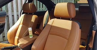 BMW 5 Series beige leather seat with a dirty and cleaned split and Colourlock leather cleaning product