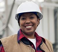 Black woman wearing a hard hat