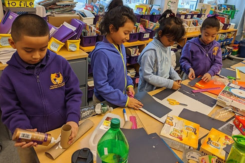Students working on an art project using recycled materials