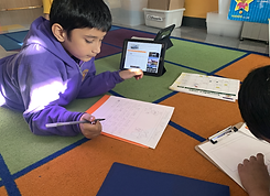 Student researching on an iPad