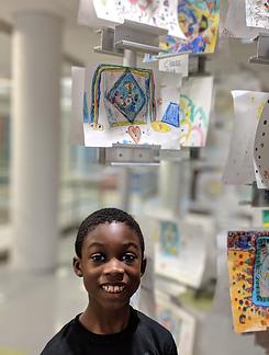 Student displaying his artwork