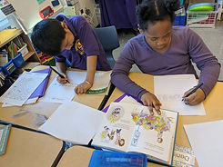 Two students completing a reading activity