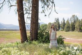 bride by tree