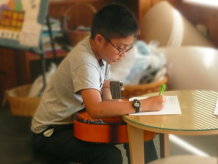 boy_guitar_writing.jpg