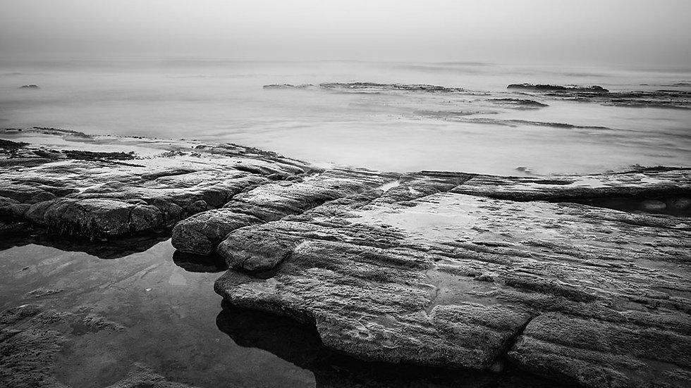 a grey dawn breaking.