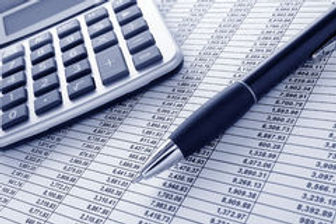 pen-and-calculator-on-cash-financial-spr
