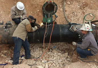 men performing pipeline integrity maintenance an repair and welding