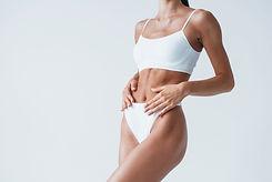 shows-white-underwear-beautiful-woman-with-slim-bo-NPSY385.jpg