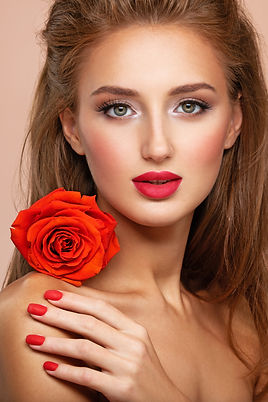 beautiful-young-woman-with-a-red-flower-