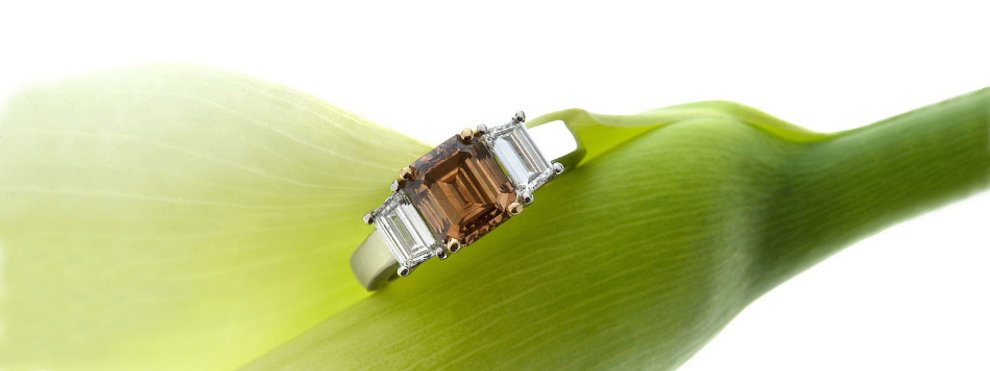 Custom desgned brown diamond and trapezoid 3-stone ring in platinum and 18K yellow gold