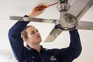 Electrician installing celing fan