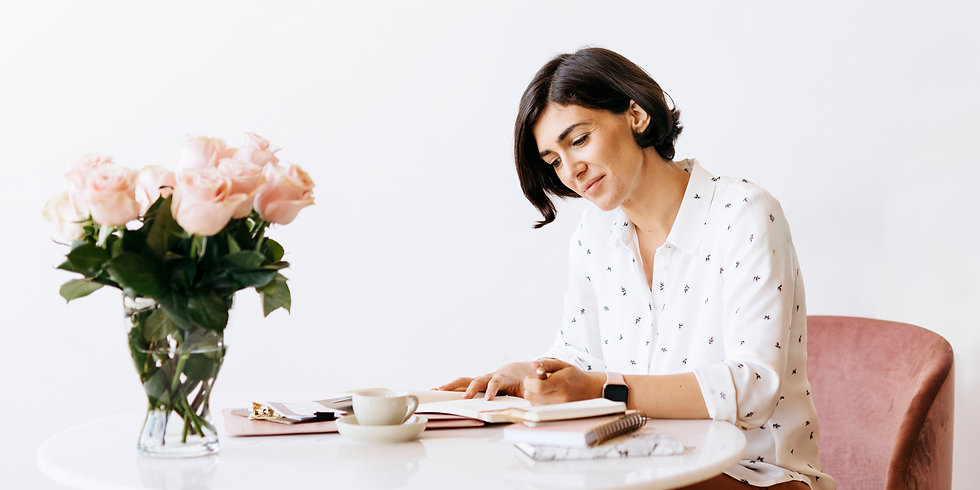 woman at desk with flowers.jpg