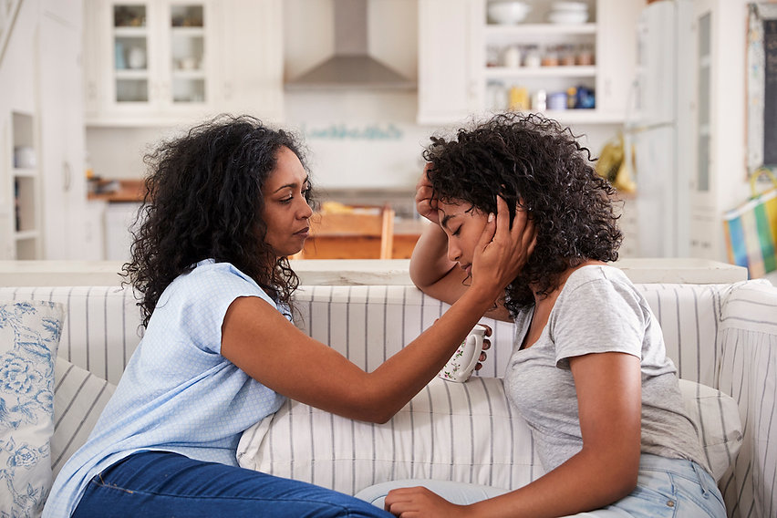 mother-talking-with-unhappy-teenage-daug