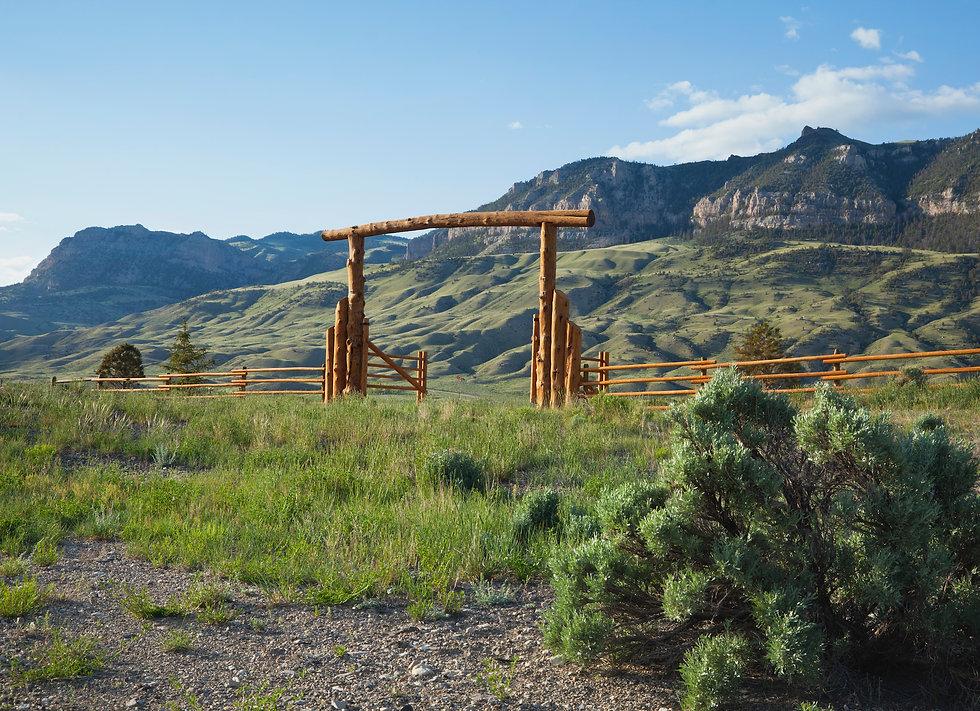 ranch-gate-below-cliffs-in-the-american-