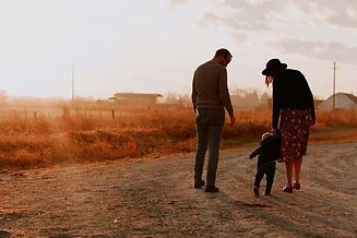man-and-woman-walking-with-there-kid-on-