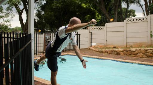 Mr. Visser giving some coaching on swimming technique