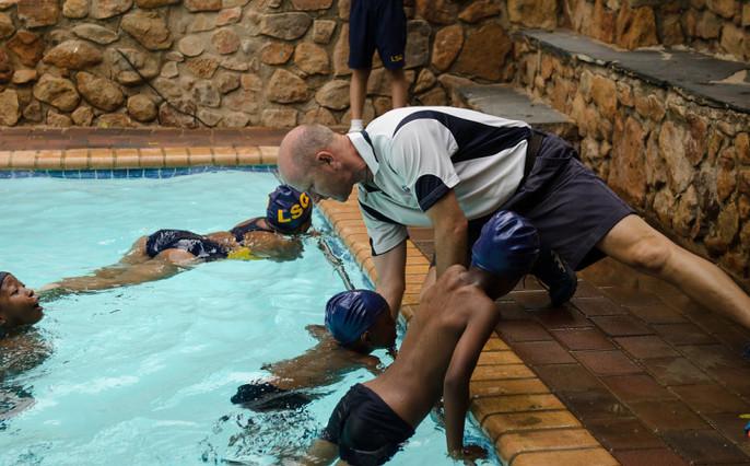 Mr. Visser Teaching swimming