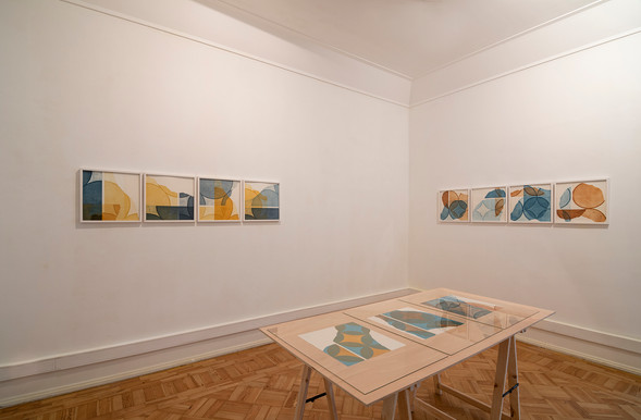 """View of Pedro Boese's """"in a row I + II"""" exhibition, 2020 © Eduardo Sousa Ribeiro, 2020 Left: in a row I, 2020 4-color Aquatinta prints on craft paper Bütten 340g 38.5 x 38.5 cm ( stain) each 40 x 40 cm (frame) Ed. 6 + 1 PA Right: in a row II, 2020 (back wall) 4-color Aquatinta prints on craft paper Bütten 340g 38.5 x 38.5 cm ( stain) each 40 x 40 cm (frame) Ed. 6 + 1 PA On the table: Untitled, 2017 (left side) Aquatinta print on 340g Zerkall Bütten paper 38 x 36 cm Single proof Untitled, 2019 (in the middle ) Print of Aquatinta on Zerkall Bütten paper of 340g 38,5 x 38,5 cm Ed. 1/6 modultypIV_38,5_r18_w90, 2019 (right side) Print of Aquatinta on Zerkall Bütten paper of 340g 38,5 x 38,5 cm Ed 2/6"""
