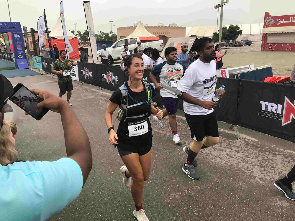 Claudia wild finishing the salalah half marathon in oman 2018