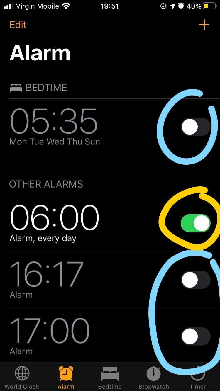 alarm app iphone with some alarms switched on and some off showing the toggles