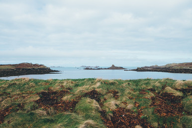 Looking_out_over_calm_water_scilly_isles
