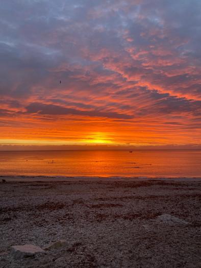 Sea_kayaking_sunset_evoke_adventure.JPG