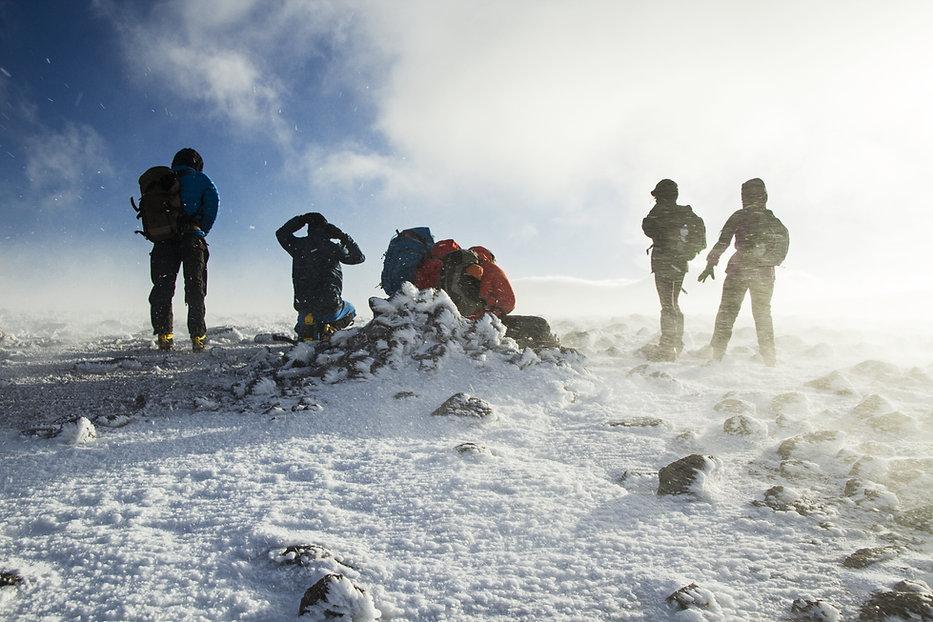 Winter walking on a windy summit