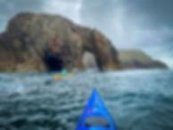 Kayaking_through_lands_end_sea_arch_evok