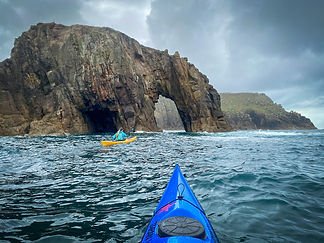 Kayaking_through_lands_end_sea_arch_evok
