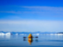 Kayaker_amongst_iceburgs_Greenland_evoke