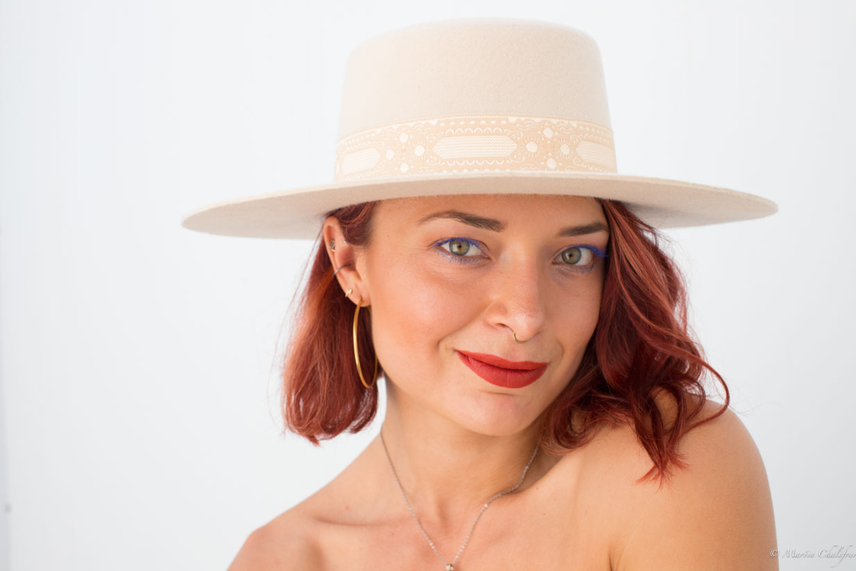 Amanda white hat headshot.jpg