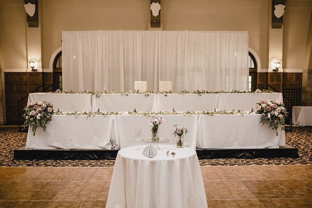 head table with white backdrop at iowa memorial union ballroom