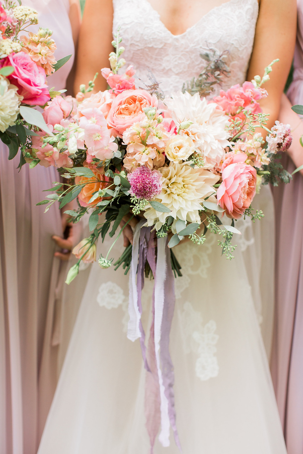 summer garden bridal bouquet by studio bloom iowa with dahlias garden roses and snapdragons in shades of pink and coral